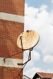 Rusty satellite dish on the outside wall Royalty Free Stock Photography