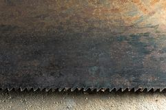 Rusty saw blade. Closeup laying down on concrete Stock Images