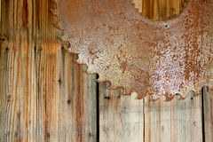 Rusty Saw Blade and Wood Stock Image