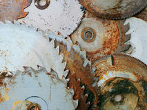 Rusty sawblades. A pile of rusty circular sawblades royalty free stock images