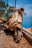 Rusty scooter on the coast Royalty Free Stock Photography