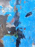 Rusty and scraped surface icy blue with the hint of red on black. Rusty and scraped metal surface with blue and red paint that is peeled of, the mirror of the royalty free stock photos