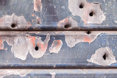Rusty and scratched metal panel background Royalty Free Stock Image