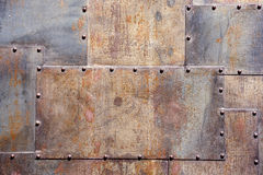 Rusty and scratched metal panel background Royalty Free Stock Images
