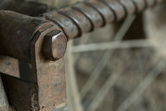 Rusty screw bolts on metallic Stock Photography