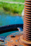 Rusty screw. Part of an abandoned machine Royalty Free Stock Image
