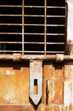 Rusty security. A rusted iron door showing aged or poor security of an old enclosure royalty free stock photography