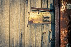 Rusty Security Lock at the Old Wooden Door Stock Photos