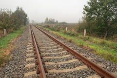 Rusty seemingly endless single track train tracks through a rura royalty free stock photo