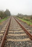 Rusty seemingly endless single track train tracks through a rura stock image