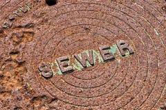 Rusty Sewer Cover Imagen de archivo libre de regalías