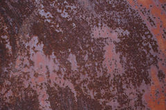 Rusty shabby metallic sheet with peeling red paint. Metal texture Stock Images