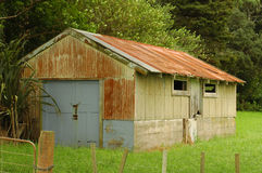 Rusty shed on concrete base Royalty Free Stock Images