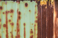 Rust on Corrugated Metal Shed Wall. The rusted side of a metal shed Stock Images