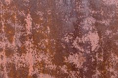 Rusty sheet of iron, with traces of paint stained stock image