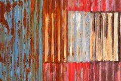 Rusty Sheet Metal With Red, bianco e pittura blu Immagini Stock