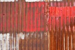 Rusty Sheet Metal With Red, bianco e pittura blu Immagini Stock Libere da Diritti