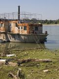 Rusty ship. Old rusty boat in polluted river Royalty Free Stock Image