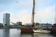Rusty ship in Amsterdam harbor Royalty Free Stock Photo