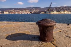 Rusty ship bollard on the dockside. Day view of rusty ship bollard on the dockside stock photo