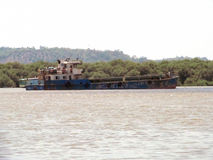Rusty ship. Its photo of rusty ship floating in river. Place - Mumbai,India royalty free stock images