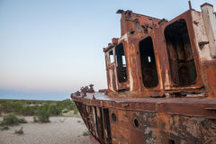 Rusty ship in Moynaq, Uzbekistan. Color image of a wrecked ship, on the former banks of the Aral sea in Moynaq, Uzbekistan Stock Photography