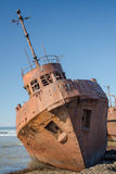 Rusty ship. Old, rusty ship on the shore Stock Photos