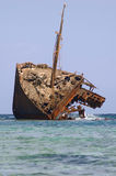 Rusty ship run aground Royalty Free Stock Image