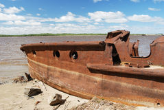Rusty ship on the shore Royalty Free Stock Photos