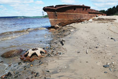 Rusty ship on the shore Stock Image