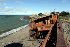 Rusty ship on the shore of the Strait of Magellan in the village of San Gregorio. SAN GREGORIO, CHILE - NOVEMBER 11,2014:Rusty ship on the shore of the Strait Royalty Free Stock Image