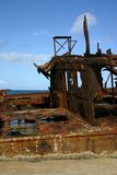 Rusty ship wreck. Rusty old ship wreck on the beach (Fraser Island, Australia Royalty Free Stock Photo