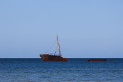 Rusty ship wreck in sea Royalty Free Stock Image