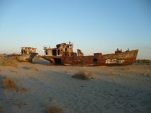 Rusty ships on the bottom of the Aral Sea royalty free stock photo