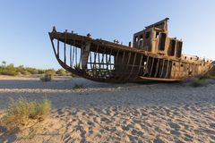 Rusty ships of the Aral Sea in Uzbekistan, after its waters have dried out. Rusty ships that have remained on the bottom of the Aral Sea in Uzbekistan Royalty Free Stock Photo