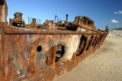Rusty Shipwreck on Beach Stock Image