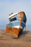 Rusty Shipwreck on a Beach Stock Image