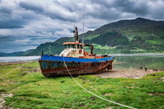 Rusty Shipwreck On Shore In Summer, Scotland, UK Stock Image