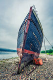 Rusty shipwreck on shore in Fort William in summer, Scotland Royalty Free Stock Images