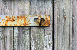 Rusty shutter on an old door. Rusty bolt on a wooden door old Stock Photos