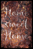Rusty sign with text Home sweet home Royalty Free Stock Image