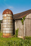 Rusty Silo and Barn Stock Photo