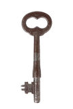 Rusty Skeleton Key. An old distressed nickel skeleton key with a flat bit and an infinity shaped bow. white background royalty free stock images