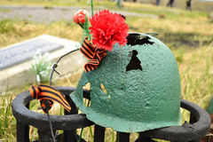Rusty soviet army Helmet with flower Royalty Free Stock Photo