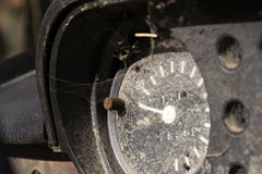Rusty speedometer on the vintage car control panel Stock Images