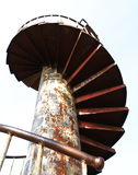 Rusty spiral stairs. Spiral stairs eaten away with rust. Look at back Royalty Free Stock Photography