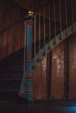 Rusty spiral stairs inside dark room. Old and rusty spiral stairs inside dark and gloomy room Stock Photo