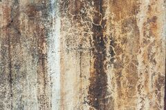 Rusty, spotted concrete background. parts of an old concrete wall, peeling paint of a cement surface. Grunge texture