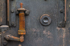 Rusty spring on old machine Royalty Free Stock Photo