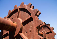 Rusty sprokets. Large rusty sprokets against a blue sky Royalty Free Stock Image